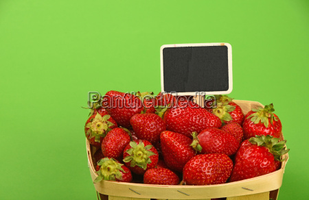 strawberry in wooden basket with price