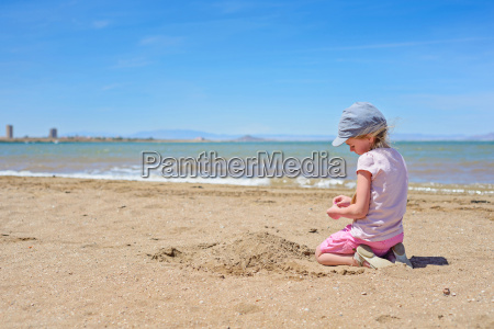 little girl playing on the mar