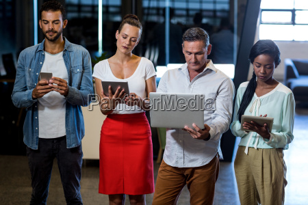 team of colleagues using mobile phone