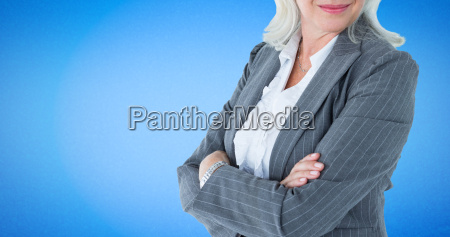 composite image of businesswoman standing arms