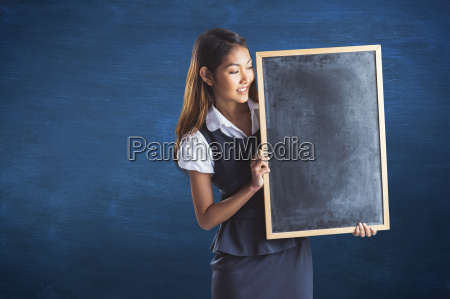 composite image of smiling businesswoman holding
