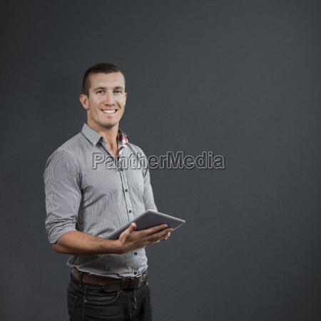 composite image of handsome businessman using