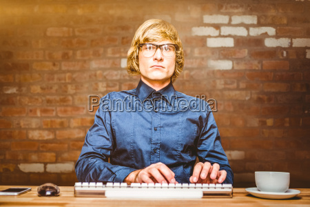 composite image of focused hipster businessman