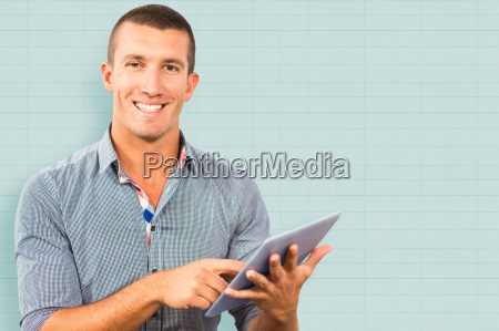 composite image of smiling businessman using