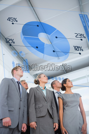 composite image of business team looking
