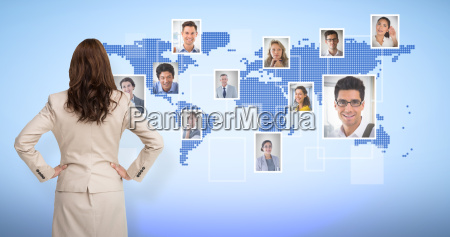 composite image of businesswoman standing back
