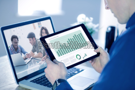 composite image of businessman using tablet