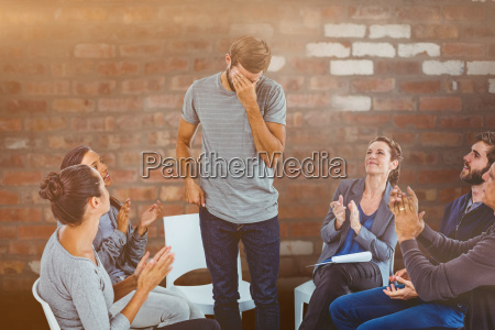 composite image of rehab group applauding