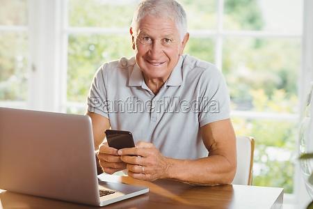 senior man using his laptop and