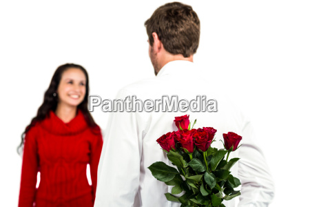 man holding bouquet of roses with