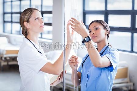 medical team preparing an iv drip
