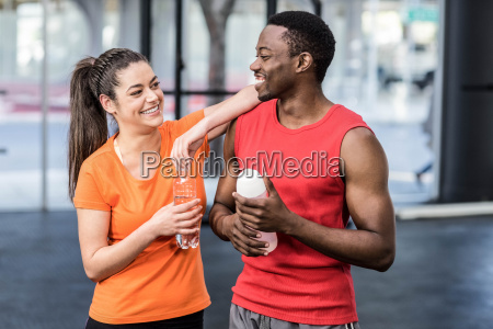 smiling woman and man after effort