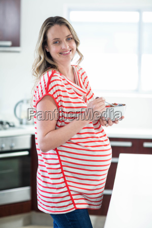 pregnant woman eating cereals
