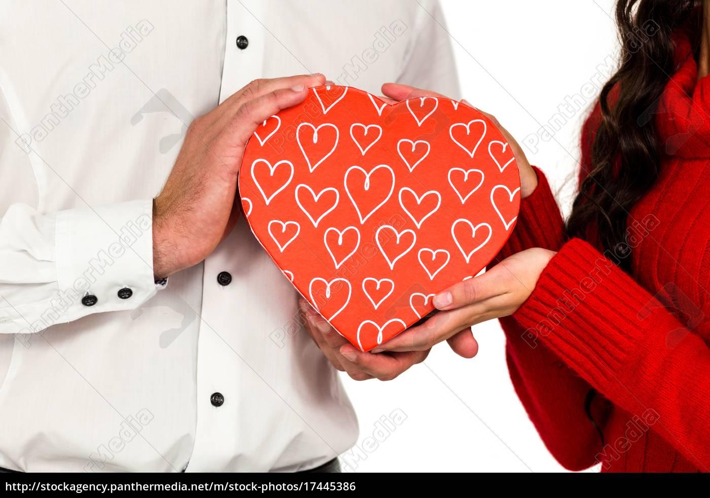 Stock image 17445386 - Couple holding heart shaped gift box & Couple holding heart shaped gift box - Stock image - #17445386 ...
