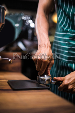 waiter squeezing the coffee in the