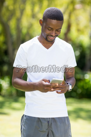 happy man using his smartphone