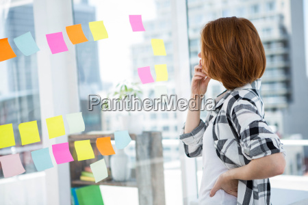 hipster woman staring at notes on