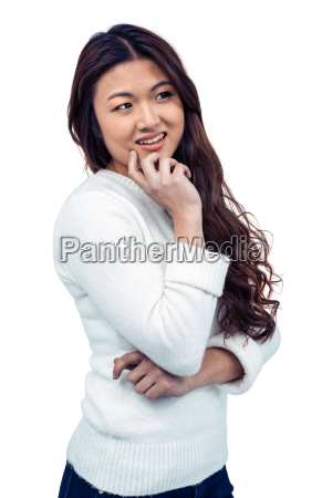 smiling asian woman with hand on