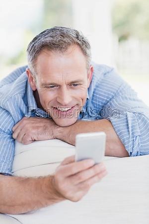 happy man using smartphone