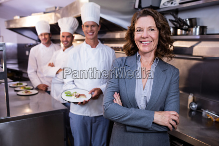 restaurant manager posing in front of