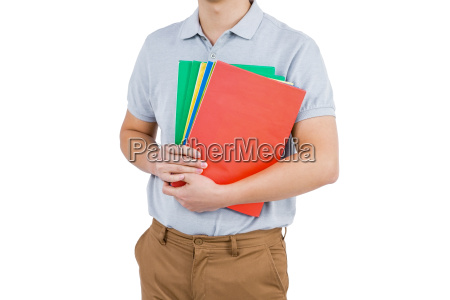 mid section of man holding files
