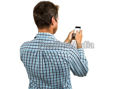 rear view of man using smartphone