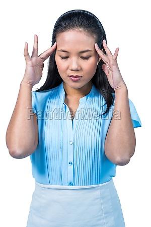 worried businesswoman holding her head