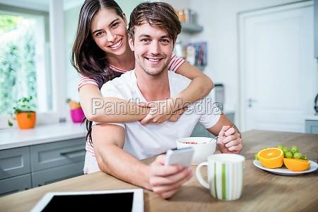 happy couple using smartphone
