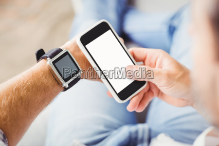 man wearing smart watch and using