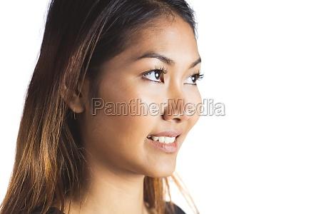smiling businesswoman looking away