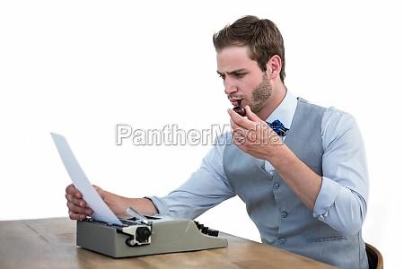 handsome man using old fashioned typewriter