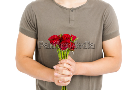 mid section of man holding bunch