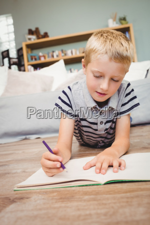 close up of boy writing in