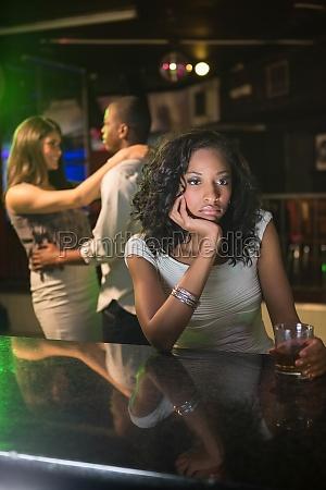 unhappy woman sitting at bar counter