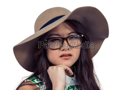 asian woman with hand on chin