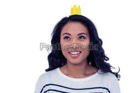 smiling asian woman with paper crown