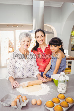 senior woman smiling while preparing food