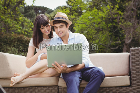 young couple looking at laptop