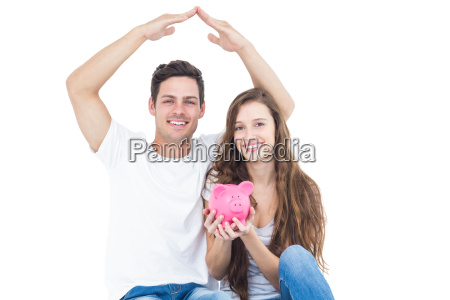young couple sitting on floor with