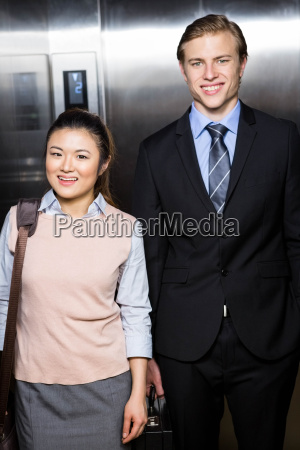businessman and businesswoman standing in an