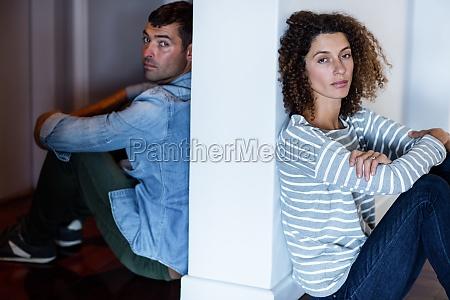 portrait of couple sitting on opposite