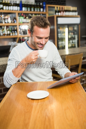 handsome man using tablet computer and