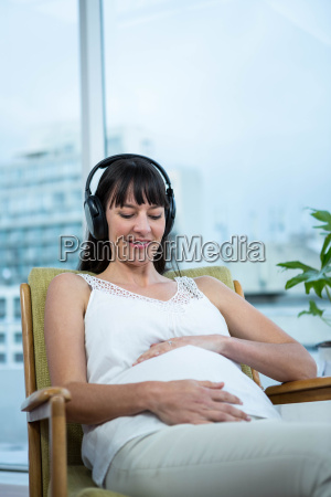 pregnant woman sitting on chair