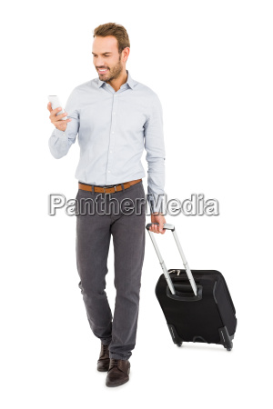 young man holding trolley bag and