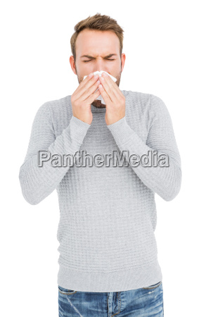 young man wiping his nose