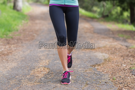 low section of woman running on