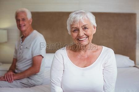 senior woman with husband sitting on