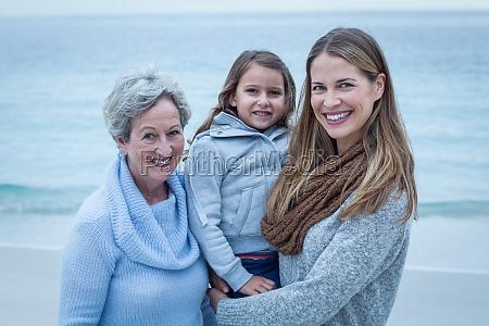 happy three generations of women standing
