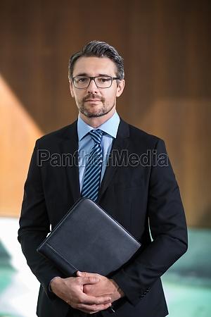 portrait of businessman standing in resort