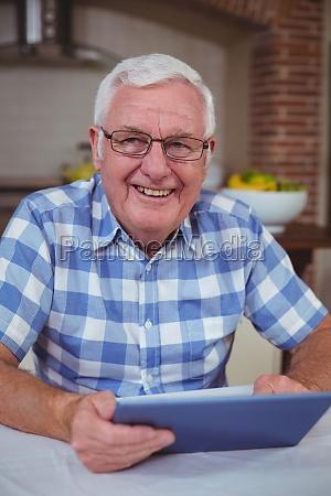 portrait of senior man with digital